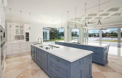 luxury-kitchen-with-contrasting-storm-gray-and-white-cabinets-with-two-islands